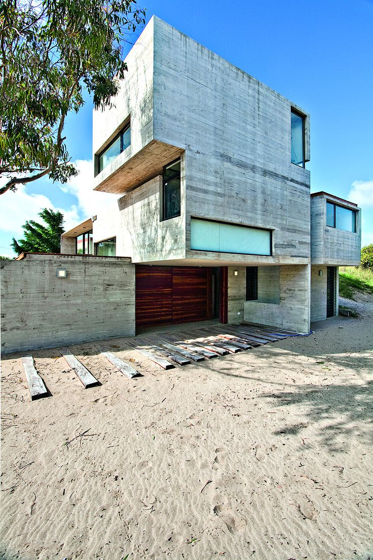 Concrete House With Industrial Features on the Beach by BAK Architects - http://freshome.com/2014/01/01/concrete-house-industrial-features-beach-bak-architects/