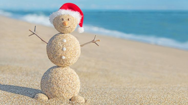 Destinations Where You Can Celebrate Christmas On The Beach, sinking your toes in the sand while sipping cocktails on the beach.