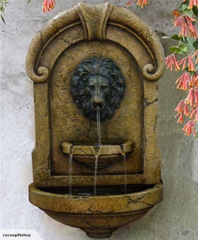 Auction for a  lion head wall hang water fountain.
