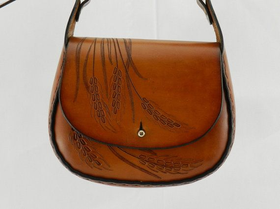 Handmade Latigo Bag - Carved and tooled Wheat pattern, hand-dyed and hand-stitched - Solid Brass hardware with brass button closure.