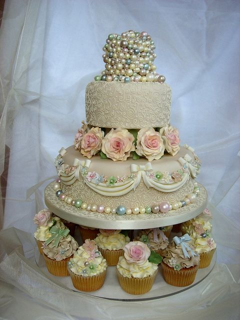 """vintage wedding cake - this is interesting. I think if the """"pearls"""" were smaller and more delicate, and the beige was a little lighter, this would be the perfect cake."""