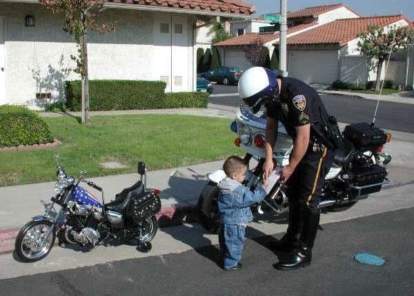 Funny children picture - this is just too cute - love his little motorcycle -