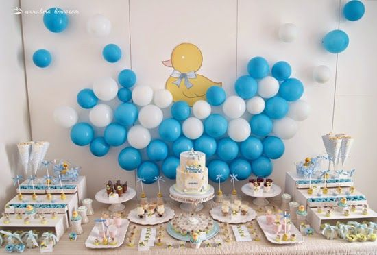 the desert table for this rubber duck themed party in blue and yellow
