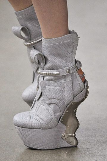 These just make me worry about the future of the human race.  [Alexander McQueen white leather booties with silver hardware]