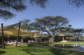 Joy's Camp, Shaba- An elegant oasis in the arid lands of Samburu; Joy's Camp is built on the site of Joy Adamson's tented home in Shaba National Reserve. The site was also home to Penny the leopard, the heroine of her last book. The 10 chic canvas bedrooms are set on raised platforms with breathtaking views of the surrounding hills. Each tent has its own private deck, ideal for private game viewing as well as relaxing, reading and soaking up the truly wild environs offered by Shaba.