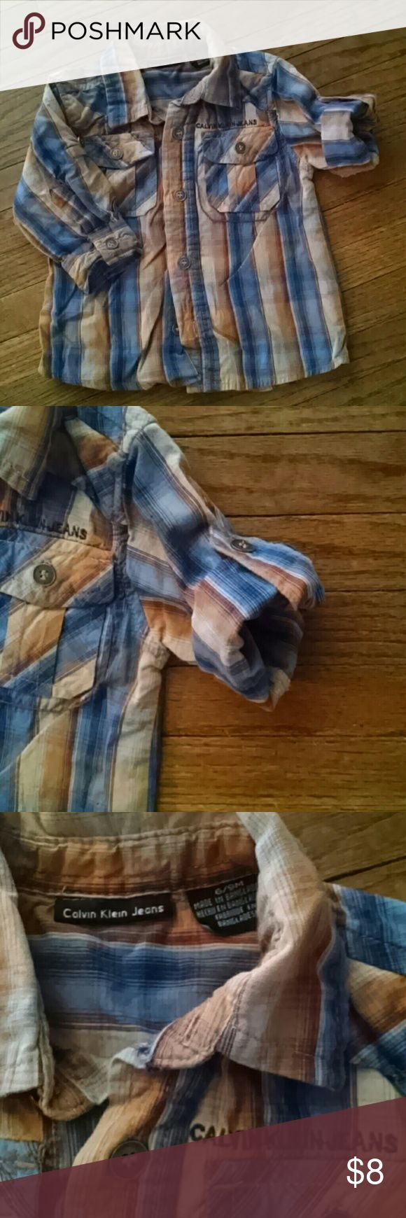 Calvin Klein Jeans Baby button up shirt 6-9 month old boys button up shirt. Sleeves roll up and can be secured by button. Super cute. Calvin Klein  Jeans to complete the outfit also for sale in my closet. Bundle up and take 15% off two! Calvin Klein Jeans Shirts & Tops Button Down Shirts
