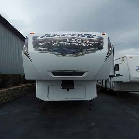 2013 Used Keystone ALPINE 3600RS Fifth Wheel in Illinois IL.Recreational Vehicle, rv, 2013 KEYSTONE ALPINE 3600RS, Beautiful used 5th wheel for sale. Come check out our 2013 Keystone Alpine 3600RS used fifth wheel. This is in great condition and features Keystone's Therma Shield, outside awning, huge storage basement, 50 amp service, 2 A/C's, roof ladder, solid surface countertops, huge 12 cu.ft. refrigerator, Dirt Devil central vac, residential style microwave, TV, fireplace…