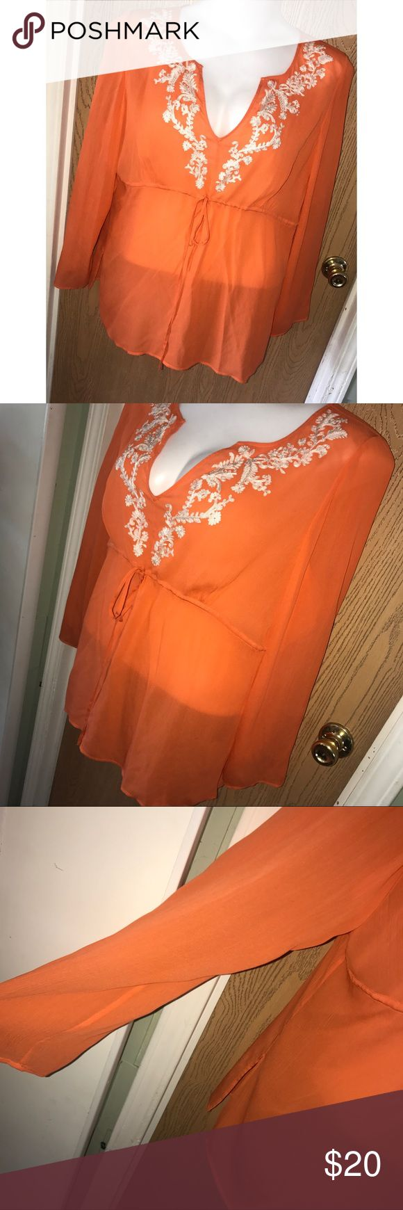 "Sheer silk embroidered orange top Super pretty sheer orange silk embroidered front tie waist top. Good used condition. 28"" from armpit to armpit, 30"" total length. i.e. woman Tops"