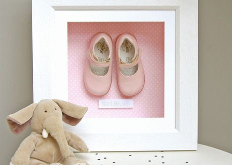 Cute framed baby shoes in a deep shadow box memory frame. Lovely idea for the nursery.