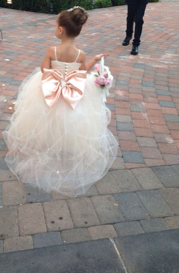 Adorable Flower Girl Dresses for the Little Miss in Your Wedding:   Full Tulle Flower Girl Dress with Large Pink Bow