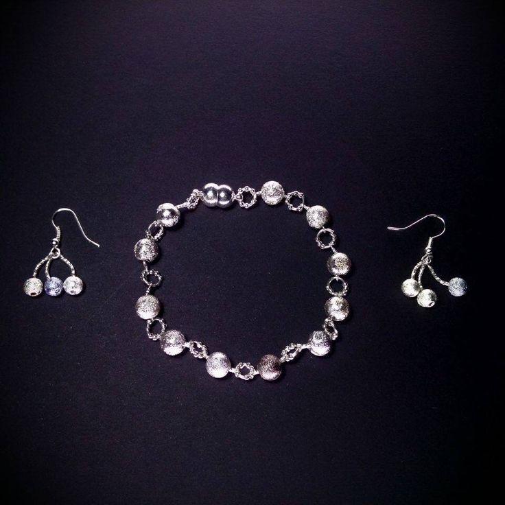 Silver cherries set by Skitsanos