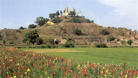 The largest pyramid, and the largest monument ever constructed, is the Quetzalcóatl Pyramid at Cholula de Rivadavia, 101 km (63 miles) south-east of Mexico City. It is 54 m (177 ft) tall, and its base covers an area of nearly 18.2 ha (45 acres). Its total volume has been estimated at 3.3 million m³ (166,538,400 ft³)compared with the current volume of 2.4 million m³ (84,755,200 ft³) for the Pyramid of Khufu or Cheops.