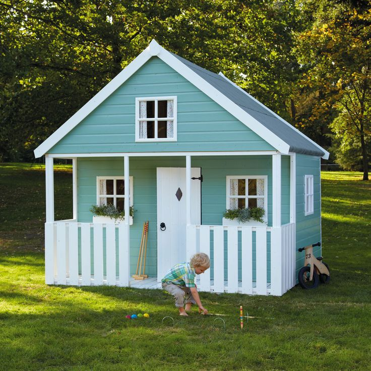 """Apple Tree Playhouse - Our most special wooden play house with plenty of room for Goldilocks AND the Three Bears - they'll play and play (and play) right up until bedtime.    All colours feature: white painted door and trim; four Georgian windows; upper bunk with stairs and hand rail; 2'6"""" verandah with returns; and safety glazing, curtains not included."""
