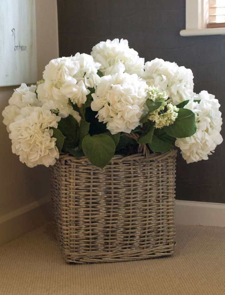 """white hydrangea in basket. Check it out! The """"artificial flower interior"""" to enjoy from """"1coin shop of artificial flower"""". (Japanese 100yen shop, 1 coin means 100yen coin in Japan. 100yen almost $1):"""