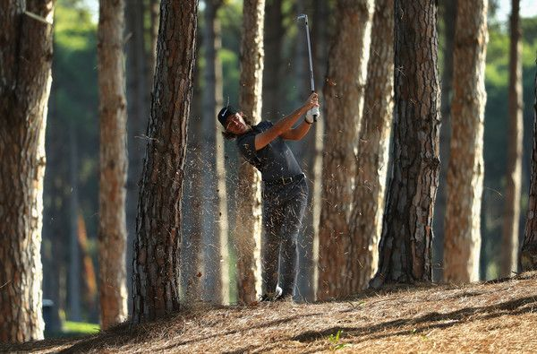 Tommy Fleetwood of England plays his second shot out of the trees on the 12th hole during the second round of the Turkish Airlines Open at the Regnum Carya Golf & Spa Resort on November 4, 2016 in Antalya, Turkey. (Nov. 3, 2016 - Source: Warren Little/Getty Images Europe)