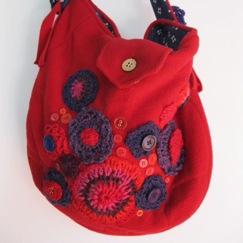 The warm colours of winter are found on this bag. Crotchet and button embellishments. See my store at www.madeit.com.au/HookandBobbin