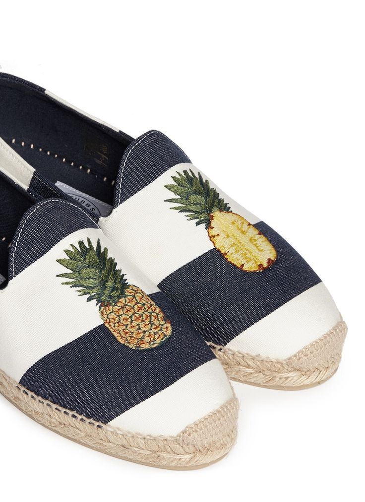 This season the fash pack champions the quirky-cute aesthetic of tropical motifs for a look that transcends from the shores. Stubbs & Wootton's canvas espadrilles are made with nautical stripes and a rounded topline for laid-back ease and style that oozes resort chic. Wonderfully embroidered with pineapple embroidery at the vamp, this pair can add an arty pastiche to looks day or night.