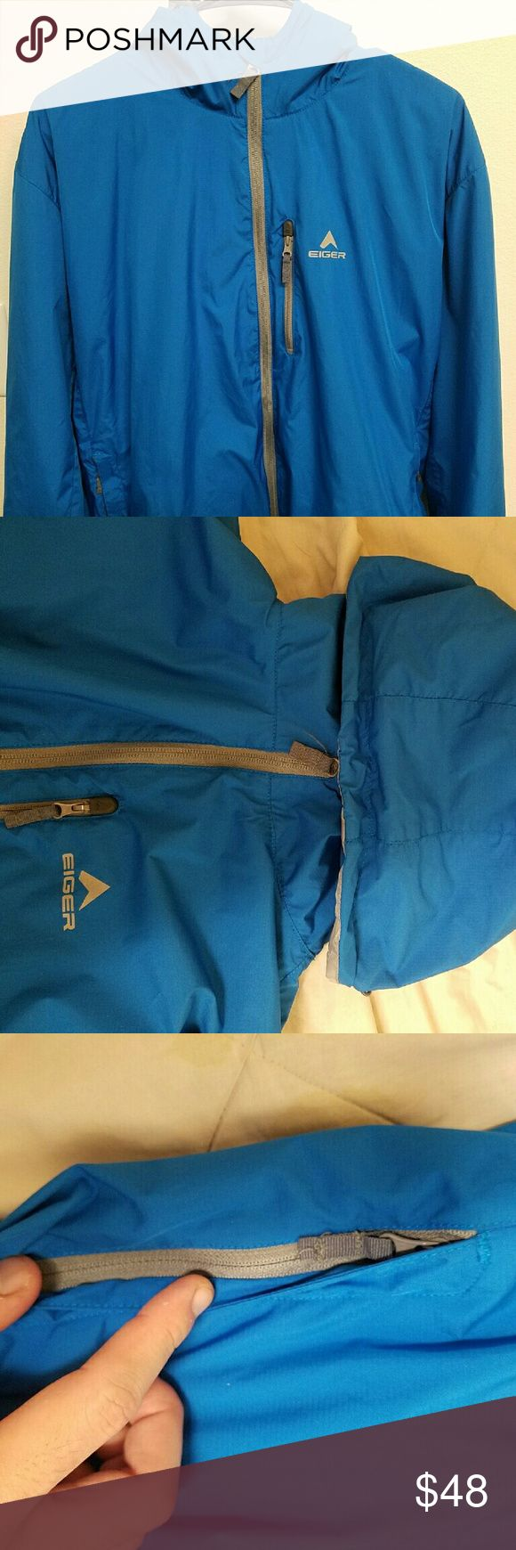 (Price reduced today) Running jacket Hardly worn. Color: striking blue. 3 zip pockets (1 chest, 2 sides) Other inside pocket Super but strong lightweight. Hooded. Great for hiking or camping or running. Gray colored Full zipper detail. Original brand: eiger   Size women L or Men M unisex Comparable product:  the north face nike element adidas superstar track  reebok Patagonia Michael Kors superdry columbia calvin klein abercrombie Vineyard vines North Face Jackets & Coats