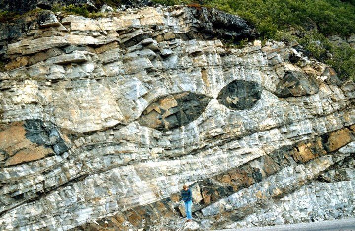 Car-sized Boudins! Boudinage forms from the stretching of a strong rock layer surrounded by less competent material.