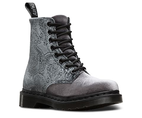 This season, the 8-eye 1460 Boot is reinvented with a seasonal Gothic flair in embossed velvet. The intricate pattern was found on an old fabric card for Victorian curtains—and in grey or navy, is a lavish, dramatic piece for your winter wardrobe. This Women's 1460 Boot is constructed on our iconic air-cushioned sole, that's oil-and-fat resistant with good abrasion and slip resistance—and has been since 1960. The boot is Goodyear-welted, meaning the upper and sole are sewn together in our…