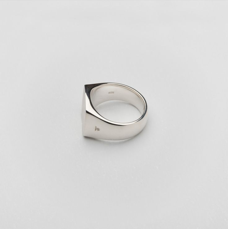 TOM WOOD #2 The simple cut of this silver ring gives it a modern expression with satin finish on the top plate. It is chunky and bold with curves that secure a tight and...
