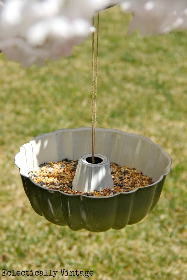 Clever idea for a bird feeder! Wrap twine around a tennis ball and put underneath the pan – bring the two ends of twine through the top and tie onto the tree