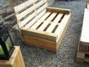 simple pallet bench...just paint it dark brown or black and set a crib mattress on the seat and you've got yourself a nice little bench