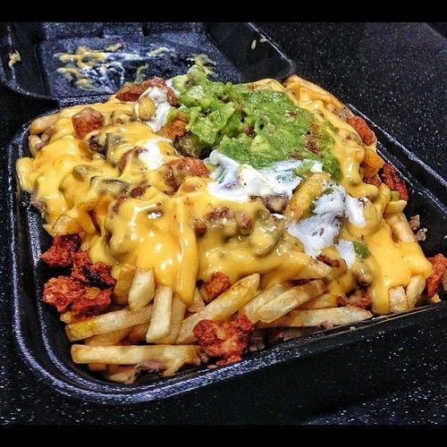 Half Carne Asada Half Al Pastor nacho cheese fries…