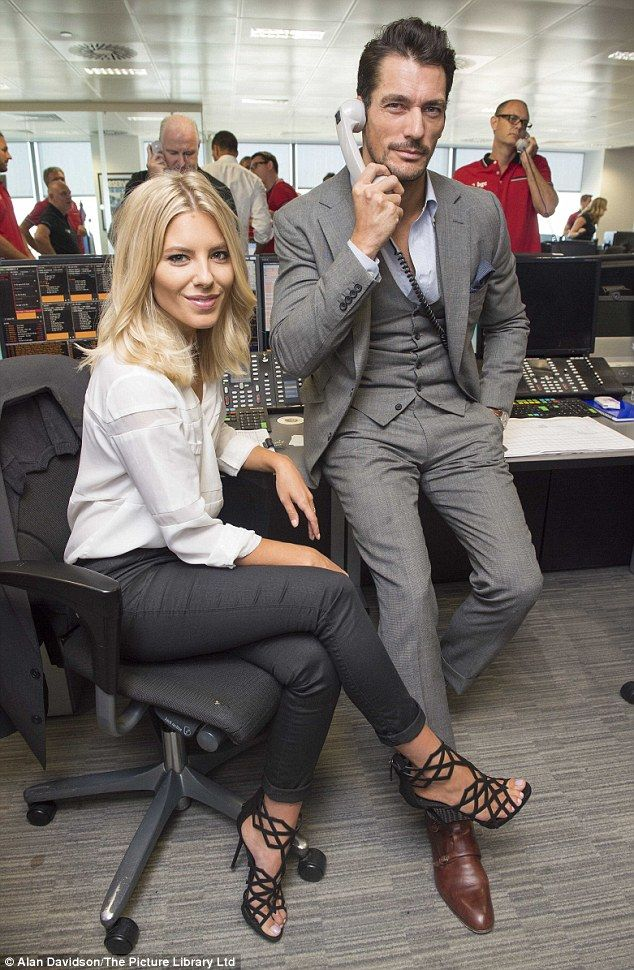 The most glamorous call-centre assistants ever? David, 35, too made for an impeccably-dressed assistant as he donned a three-piece grey suit