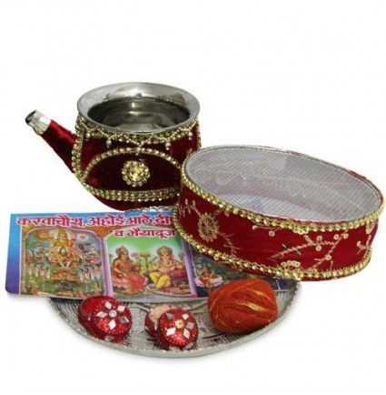 Celebrate your eternal bandhan with this attractive Karwa Chauth thali. It includes a decorated Lota, 1 chalni, 1 sindoor, 1 chawal box, katha book and 1 kalawa.