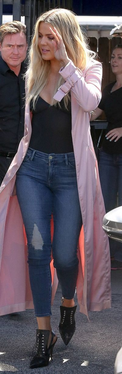 Khloe Kardashian: Coat – House of CB  Shirt – Fortnight  Purse – Hermes