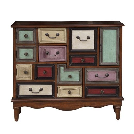 With six doors and two drawers, this apothecary-inspired accent chest boasts plenty of storage and makes a distinctive addition to any room. An eclectic mix of colorful painted finishes enhances its design while a warm brown finish and burnished brass hardware complete the look.