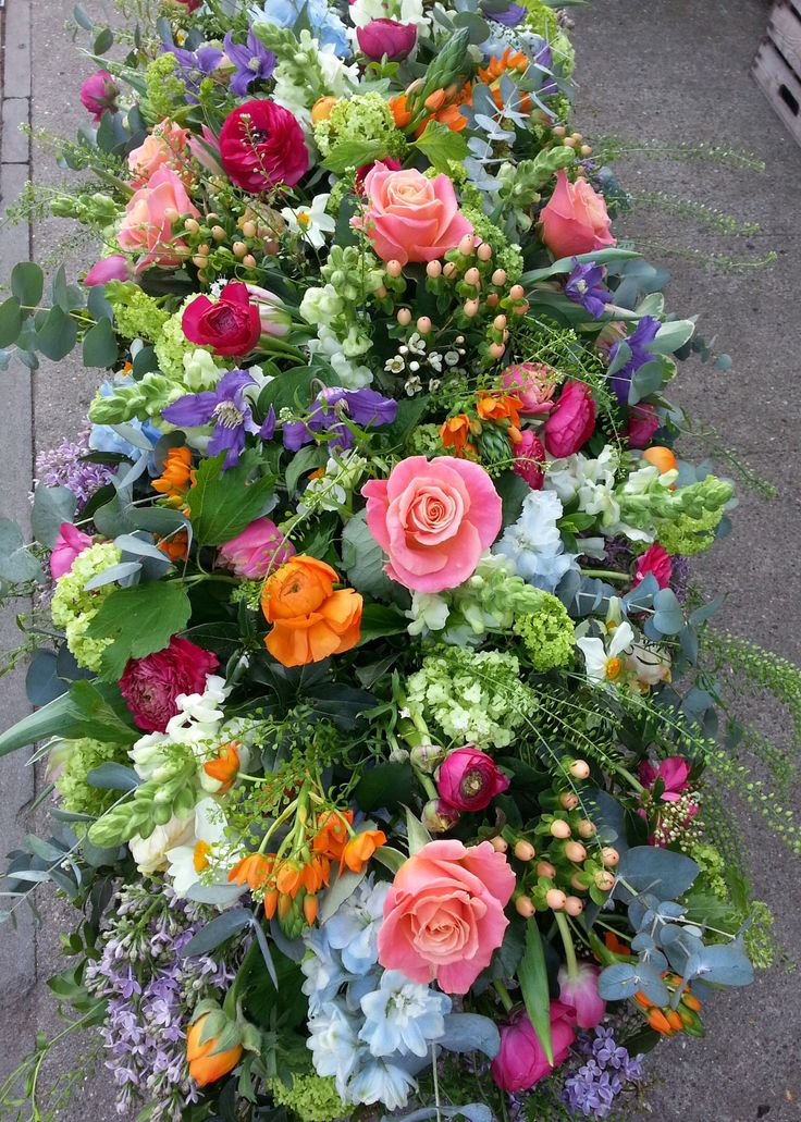 colorful coffin spray #floral #funeral #tribute
