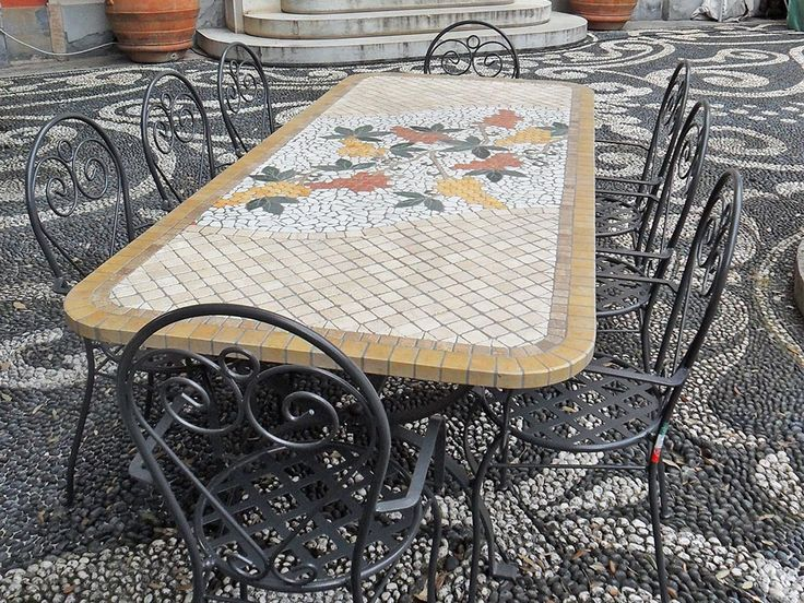 #mosaic #table #top wit #ironchairs
