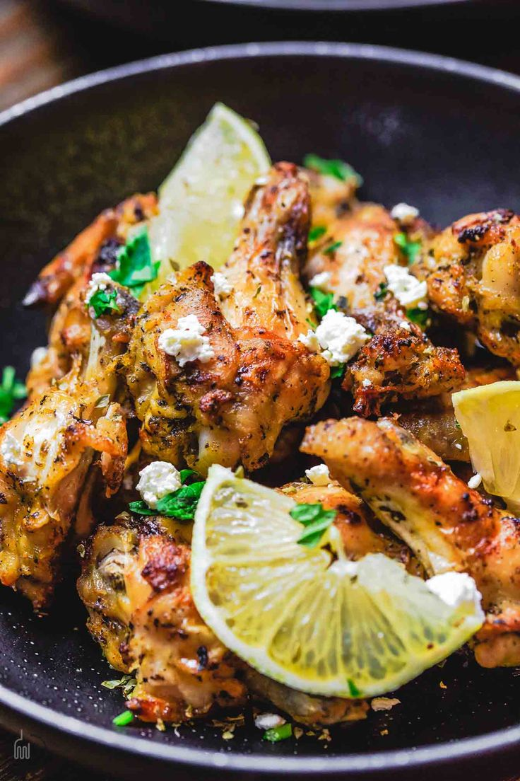 Greek Chicken Wings Recipe   The Mediterranean Dish. These chicken wings are the BEST! Easy, flavor-packed baked chicken wings that have been marinated Greek-style with olive oil, lemon juice, garlic and more! Get the recipe on TheMediterraneanDish.com
