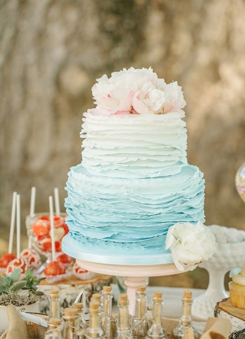 Round two-tiered flower topped mint ombre ruffled wedding cake. Photo by What a Day! Photography. Found on www.bridebug.com