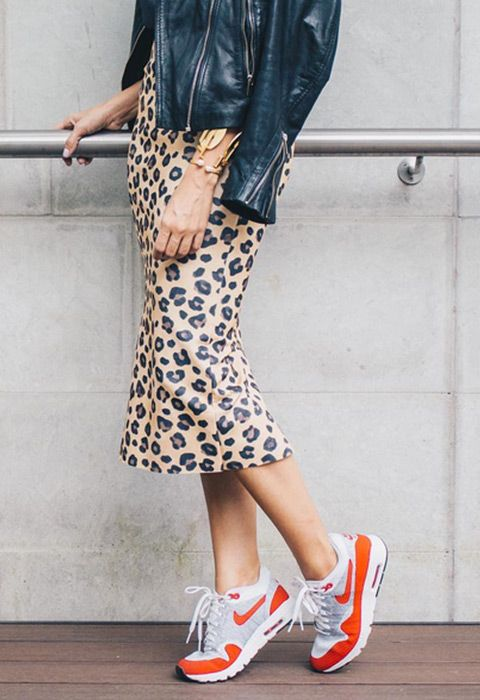 Pair your technical gym kicks with glam gear for a chic outfit with a touch of streetwear style. Team a ribbed long-sleeved tee with a sleek leopard-print skirt and clash it with chunky trainers. Finish with your fave leather jacket and you've got yourself a goals weekend look