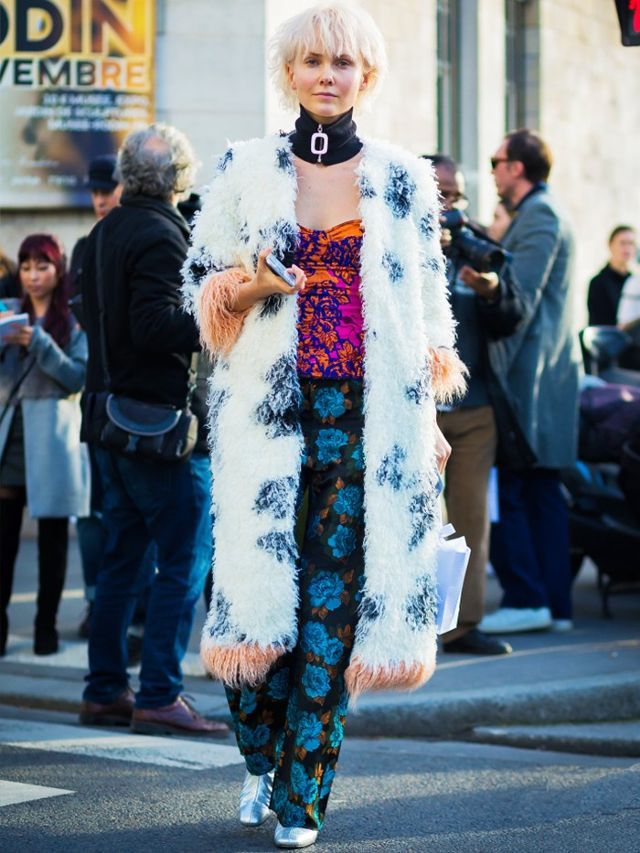 Style Notes: Olga Karput goes all-out wacky in her Shrimps coat with brocade separates, silver shoes and a neck collar. More can be more, if you're feeling brave enough.