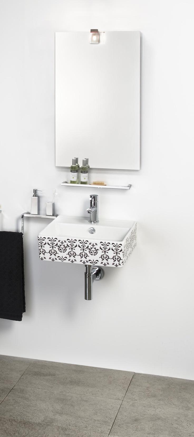 Lavabo LOFT fabricado en porcelana blanca con decoración barroca en color negro.
