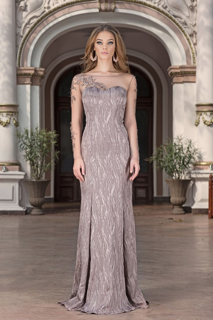 Make it a night for romance in this evening gown by Vero Milano!Fringed garlands of tonal beading adorn the sheer, ballet sleeves, sweetheart lining and a glamorous train is exquisite!