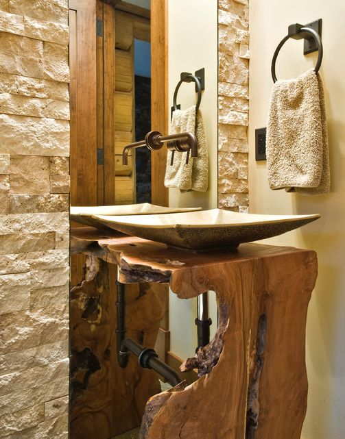 Daltile tumbled stone tiles rectified without grout. Reclaimed wood vanity support.