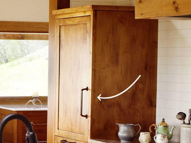 Ree Drummond's kitchen 5 of 8  fridge paneled like a cabinet (thepioneerwoman.com)