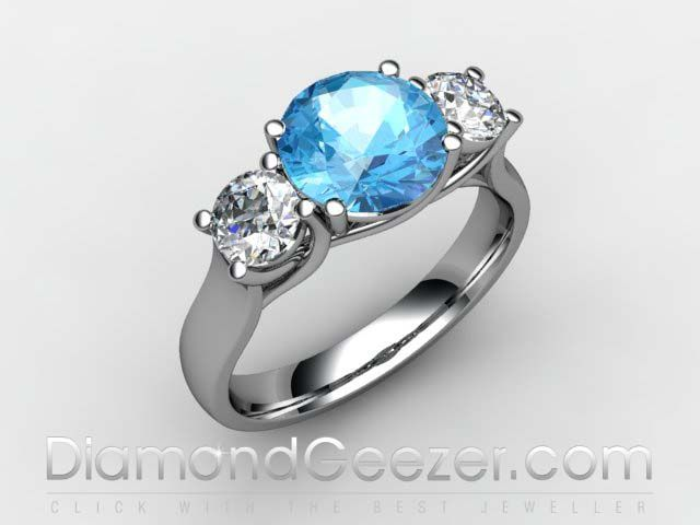 Diamond and Blue Topaz Trilogy Ring. Topaz is often associated with love and loyalty and is considered the birthstone of November.