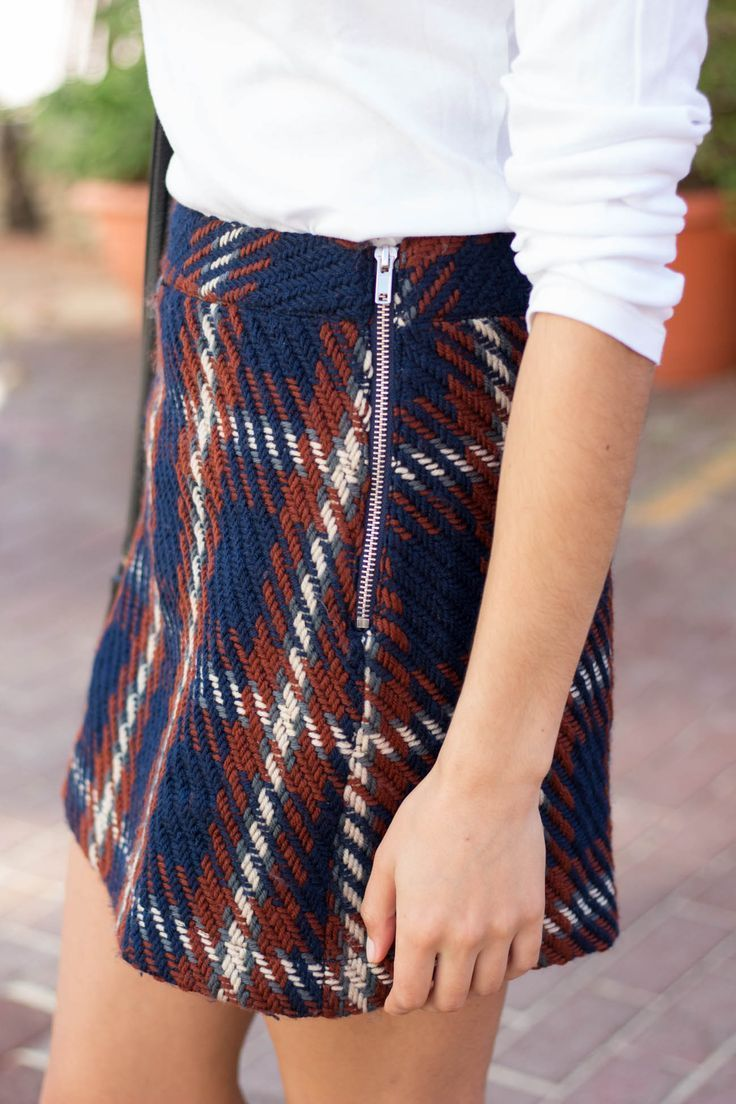 Love this plaid skirt for fall, would probably pair it will some navy tights, brown ankle booties or riding boots, and a simple white long sleeve or white sweater. Maybe my khaki trench coat for warmth.