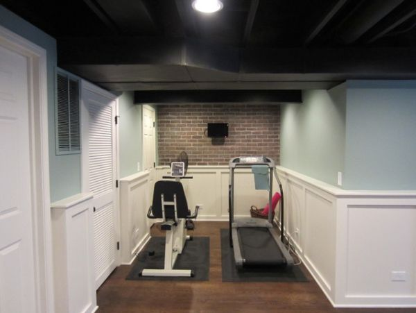 Small home #gym nook in the basement with basic indoor fitness equipment, e.g. our #elliptical. Maybe add a mirror and a floor mat. If only the ceiling was high enough