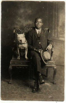 A very dapper gentleman and his Pit Bull. Lovely studio portrait.:
