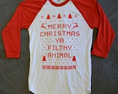 Sweat Shirt: Merry Christmas Ya Filthy Animal, in Red,  Sizes S-4X. $19.99, via Etsy.