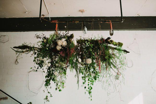 Hanging greenery altar decor | Photo by: Phil Chester via Green Wedding Shoes #weddingdecor #greenery #altar