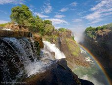 a rainbow, a waterfall