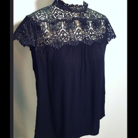 Mitto - Black Crochet Lace Collar Top Very classy black Flowy top with crocheted lace detail. Excellent condition! Mitto Tops
